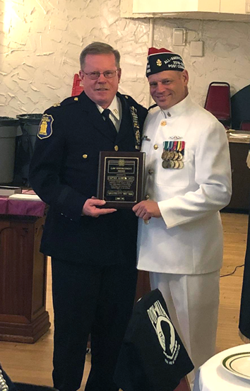 Yonkers Police Captain Andy Lane, one of their latest Medal of Honor recipients, is receiving the VFW's NYS Law Enforcement Officer of the Year award from YPD Lt. Jim McGovern. Commander of VFW Post 1666.